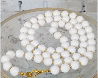 Long beaded white and gold tone necklace