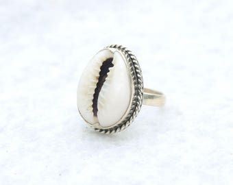 Sterling Silver Cowrie Shell Ring with Twist