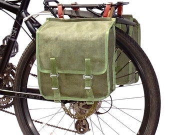 A Pair Of 1980s Ex-Army Showerproof Canvas Pannier Bags With Leather Straps vintage green large bike panniers rainproof NOS
