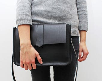 Black leather purse with a secret magnet closing