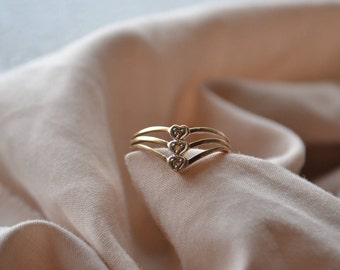 Sweet 10K yellow and white gold vintage triple-split shank chevron ring with Diamonds in heart-shaped settings
