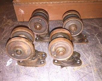 "Early double wheel rustic cast iron 3-1/2"" caster set of 4 vintage factory wheels."
