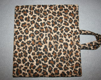 Art and activity bag, travel tote, pencil case with zip, drawing and note pad holders. Animal print.