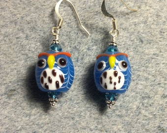 Turquoise and white spotted lampwork owl bead earrings adorned with turquoise Chinese crystal beads.