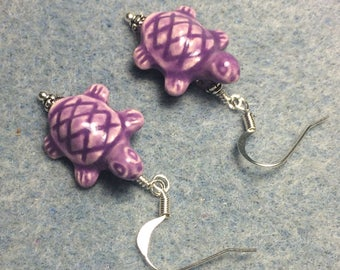 Purple ceramic turtle bead earrings adorned with purple Chinese crystal beads.