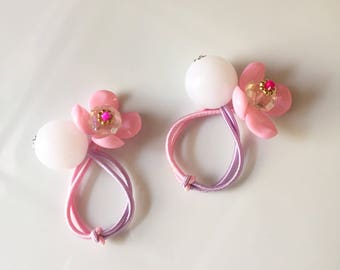 Flower ball ponytail holders, hair ties, elastic bands. New twist on retro balls hair bands with rhinestone accent!
