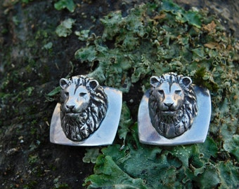 SUSAN CUMMINGS earrings, dimensional lion clip earrings, sold out rare and wonderful.  Endangered species, animal advocate.