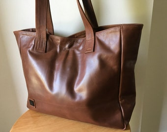Classic, classy brown leather tote,super soft leather. Timeless and traditional handmade tote,strong straps,Large leather tote bag, lined.
