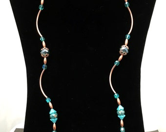36 in Necklace with copper spacers, 10mm glass turquoise rondel crystals and filigreed bead caps. Single or double STRANDED.