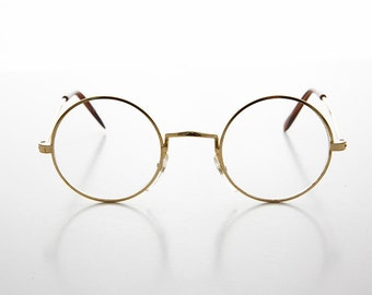 vintage 1980s gold round john lennon frame with clear lenses yale