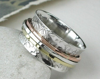 Floral spinning ring