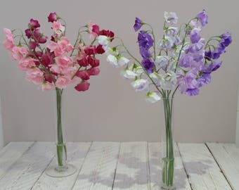 Faux silk sweet pea flower arrangement Tall elegant clear glass vase Artificial Mauve Purple Pink Salmon sweet peas Lilac summer flowers