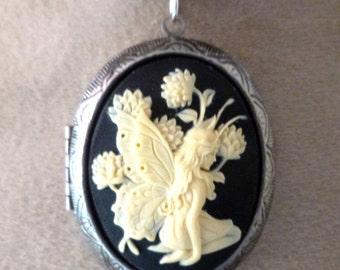 Medallion has cameo photo fairy