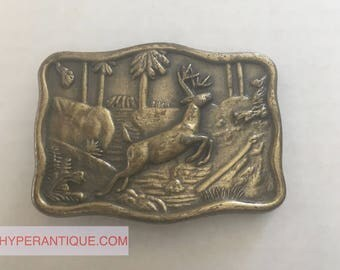 Vintage belt buckle - Deer running in the woods jumping a stream