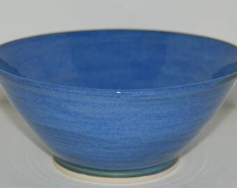 Handmade large blue pottery bowl.