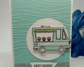 Birthday card with a cake truck, van, on an embossed background