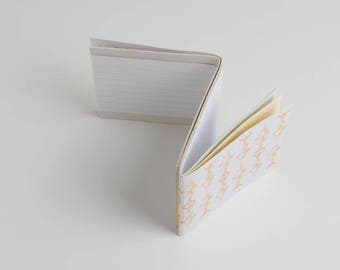 Double reversible notebooks. Covers are made with colored cardboard. Pocket size!