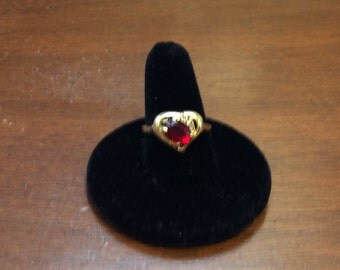 14K yellow gold simulated Ruby ring with heart shaped design. Size 6.