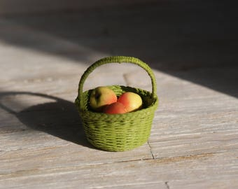 A  miniature basket with apples