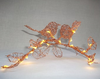 light up copper lovebirds on a branch