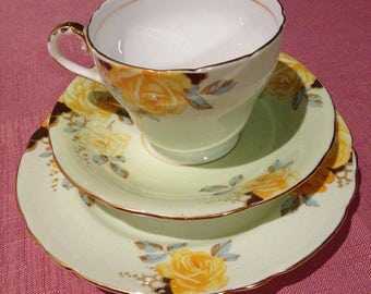 Aynsley vintage china tea cup trio, green with yellow roses.