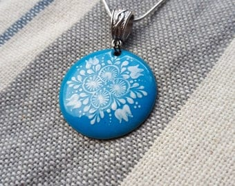 Light blue and white hand painted enamel ornament as a pendant necklace