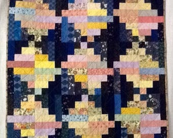 """This split log pattern quilt is a nice 36x36 inches.  Made with alternating blue and pastel  """"logs""""."""