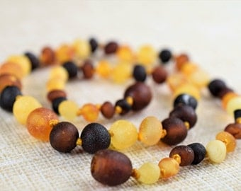 Raw Unpolished Baltic Amber teething necklace for your baby handmade knotted. Multicolor. Maximum effective amber necklace.