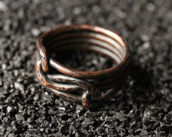Sturdy copper love knot ring.