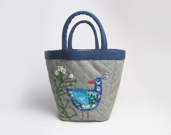 Grey felt project bag with hand embroidered bird and shepherd's purse