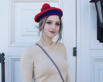 red and blue pom pom beret