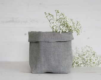 Grey storage basket handmade from eco-friendly natural linen fabric