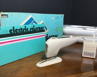 The Electric Scissors by Montgomery Ward, Three Speed, Lighted with Cutting Stand