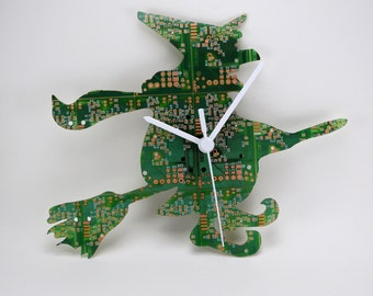 Clock plate of circuit printed green and copper with form of witch (PCB Printed Circuit Board, computer Geek, Steampunk technology)