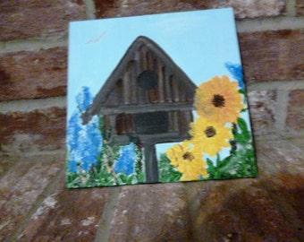 Birdhouse and Sunflowers