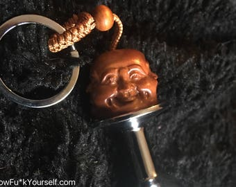 4 faced Buddha butt plug key chain! Enlighten yo self fool, with this small stainless steel toy - Mature