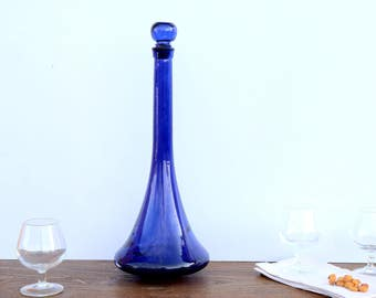 Large bottle blue glass, blue vase, vintage doilies