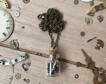 Vintage necklace with glass bottle filled with watch movement parts - nickelfree - steampunk jewelry - made by: Handmade by Charlie