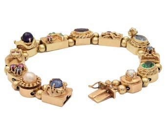 14KT Yellow Gold Ladies Cast & Assembled Slide Charm Bracelet.  A classic!
