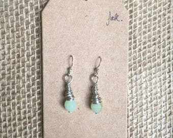 Wire wrapped green faceted glass bead earrings
