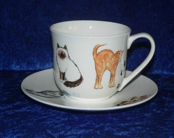Cats cup and saucer set. Bone china cup and saucer decorated with cats all round