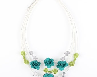 Handmade artistic necklace with blue roses