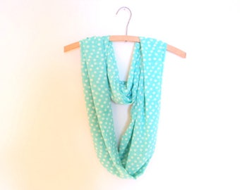 Turquoise infinity scarf. Accessory mode for girl or woman. Pale blue summer with white pins scarf.