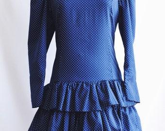 Blue polka dot ruffled dress.