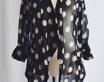 Transparent white polka dot black blouse