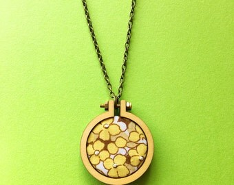 Necklace: Embroidered floral 70s vintage fabric hoop pendant