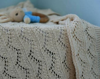 Hand knit lace baby blanket