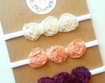 Cream, peach, or maroon flower headband