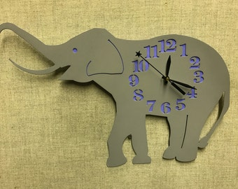Upcycled Elephant clock made from old refrigerator steel