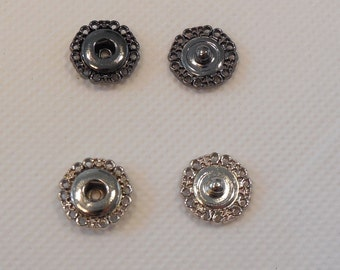 A light metal silver or grey black snap fastener press stud popper snap in floral shape in width 1.5cm is for sale. Sold by per snap